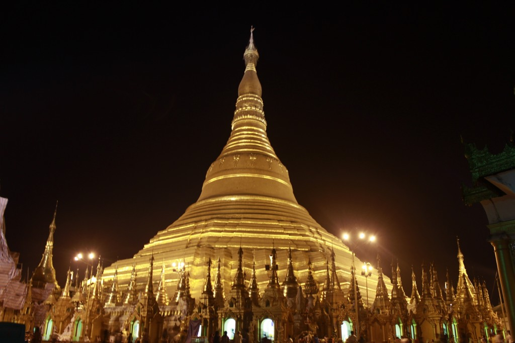 The lit-up gold of the Shwedagon Pagoda can be seen across the city of Yangon at night The Shwedagon Pagoda at night (photo by Grace, one of our writers)