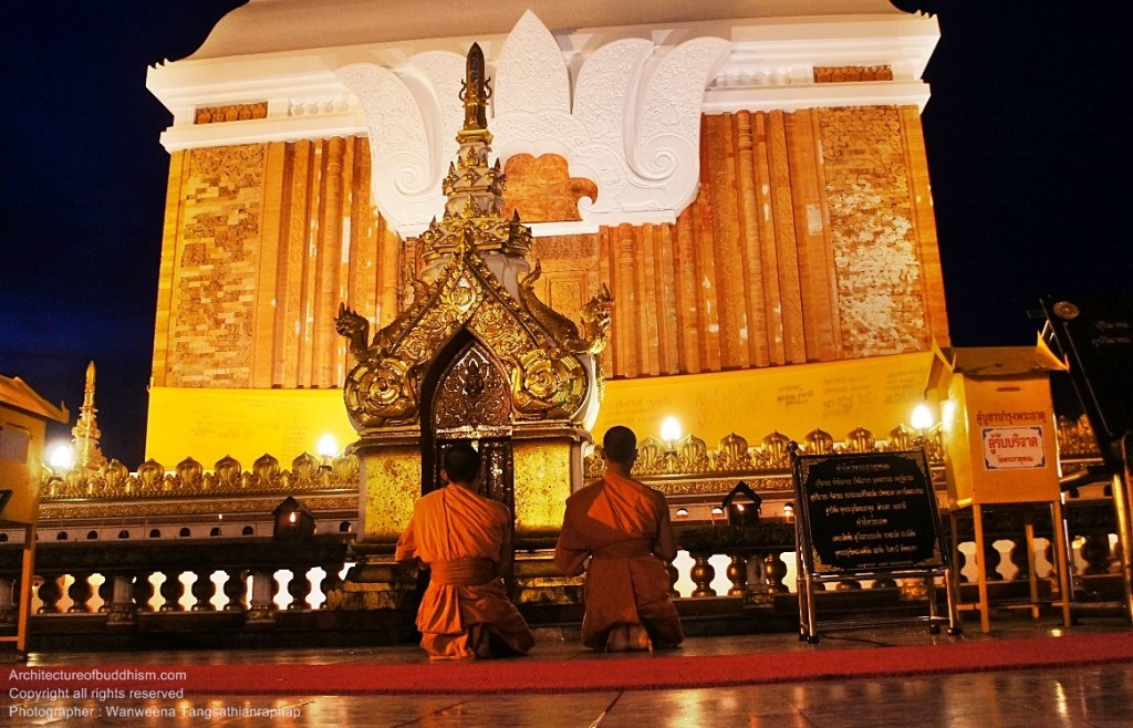 Monks praying in front of chedi