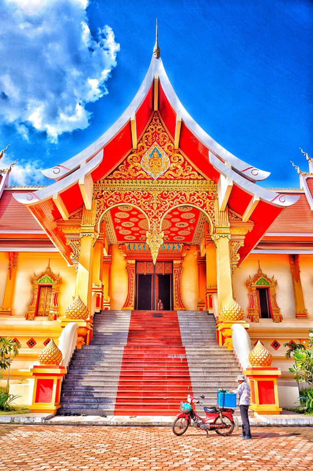 The decorated doorways of Wat Neua That Luang with a little artistic licence in the colour processing :)