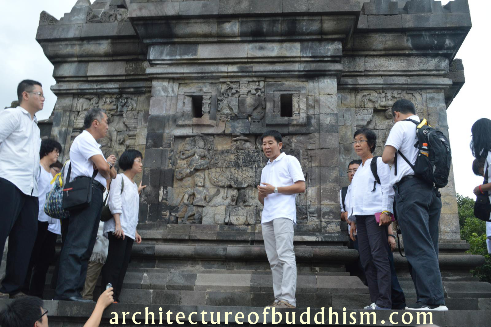 Brother Tan, explaining the history and features of Candi Pawon