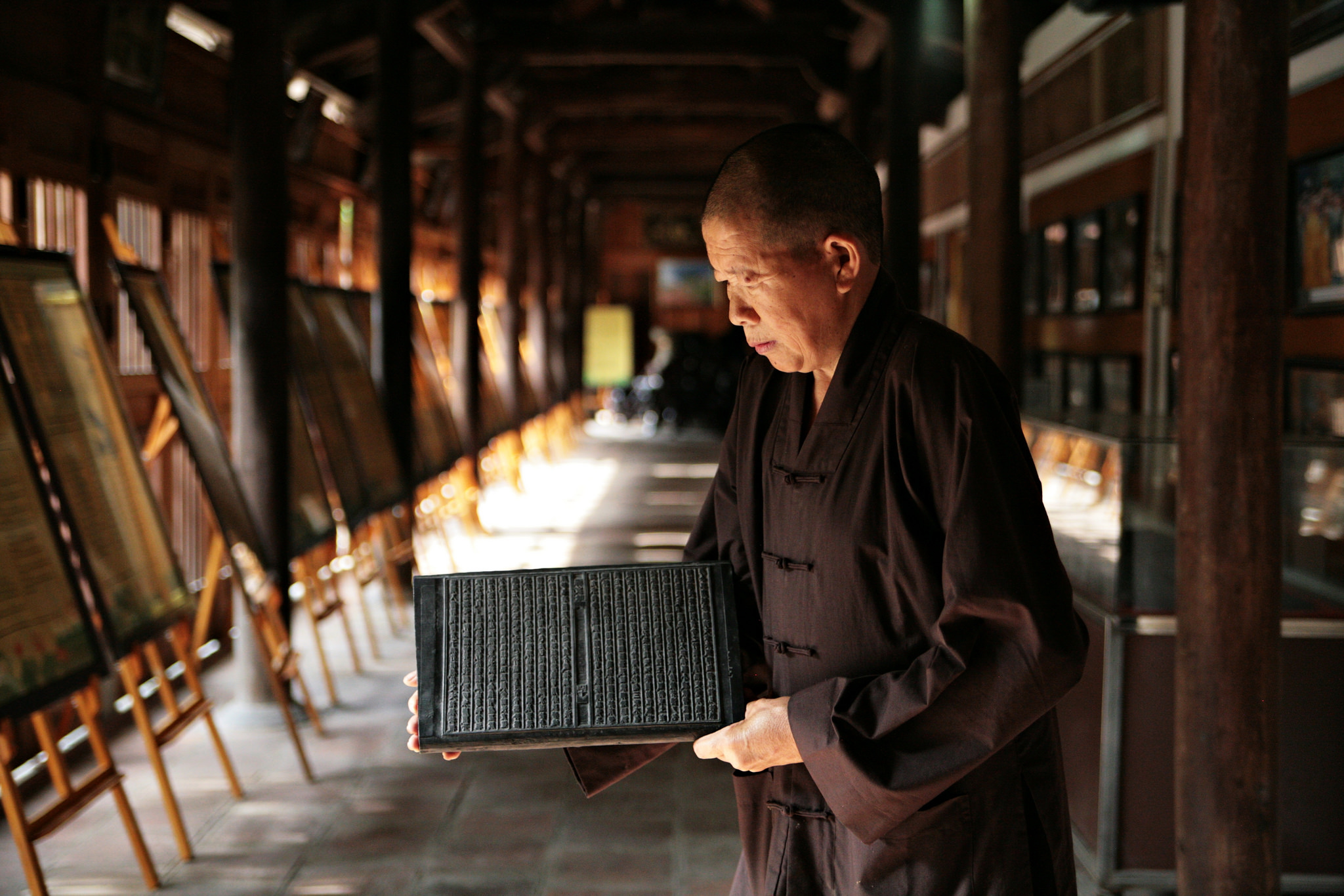 Monk with scriptures at Duc La Pagoda, Vietnam