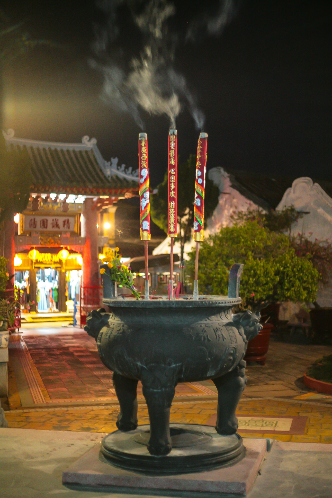 Burning incense in the courtyard at Phuoc Kien Assembly Hall, Vietnam